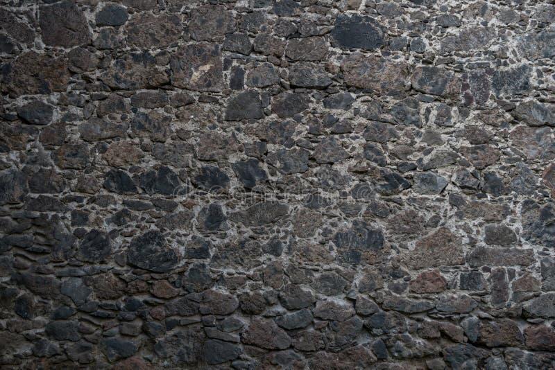 De textuur van de steenmuur in donkergrijs royalty-vrije stock foto