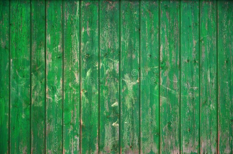 De textuur van een oude rustieke houten die omheining van vlak verwerkte raad wordt gemaakt Gedetailleerd beeld van een straatomh royalty-vrije stock foto's