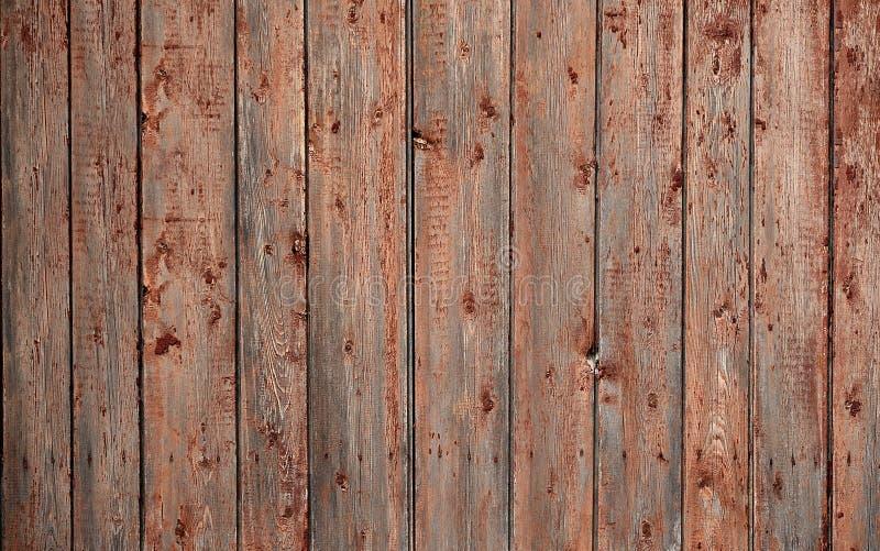 De textuur van een oude rustieke houten die omheining van vlak verwerkte raad wordt gemaakt Gedetailleerd beeld van een straatomh stock fotografie