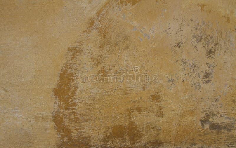 De textuur van een sinaasappel schilderde doorstane muur royalty-vrije stock afbeelding