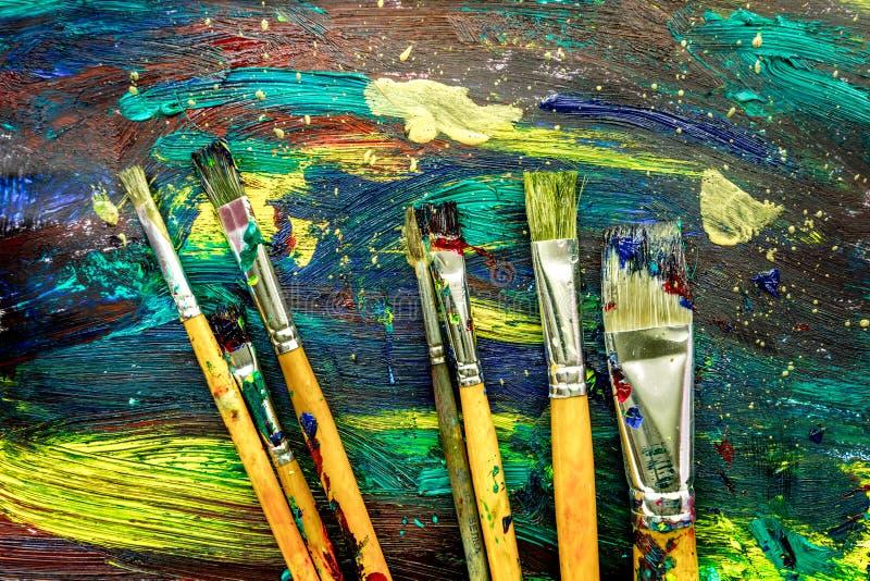 De textuur van het kleurenolieverfschilderij met borstels voor heldere achtergrond stock foto