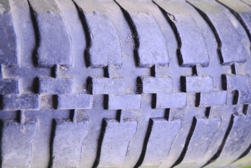 De textuur van het loopvlakwiel Oude band dichte omhooggaand De textuur van het loopvlakwiel Oude band dichte omhooggaand Tuinkar stock foto's