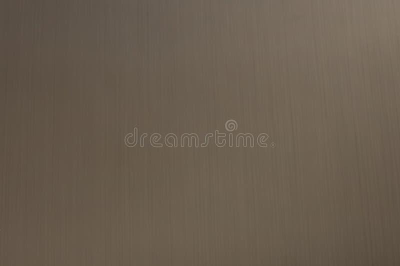 De textuur van het metaal is roestvrij staal, met schaduwen, wijzend op de oppervlakte, longitudinale strepen royalty-vrije stock foto
