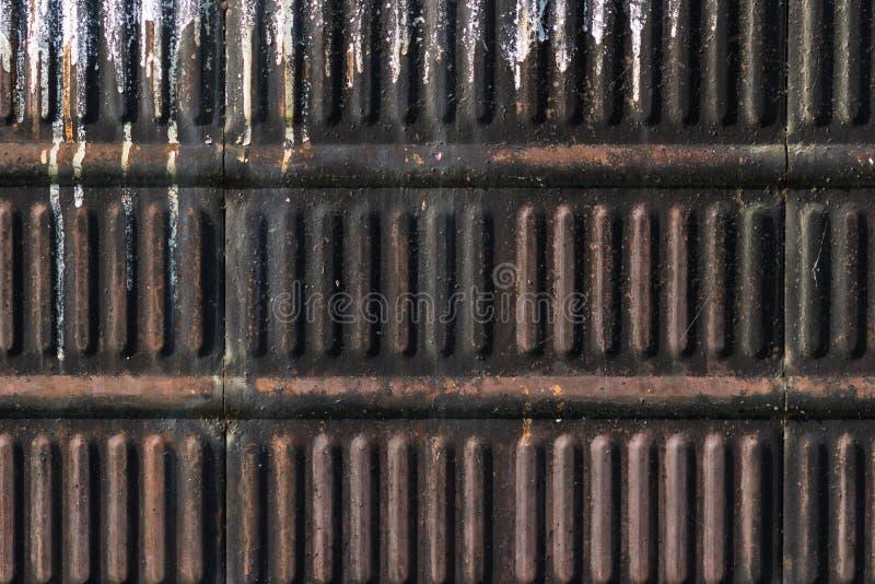 De textuur van het oude ijzer is rood en bruin Achtergrond voor tekst royalty-vrije stock afbeelding