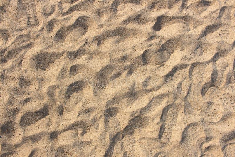 De textuur van het zand Bruin zand Achtergrond van fijn zand royalty-vrije stock foto
