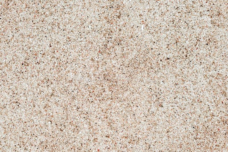 De textuur van het zand Bruin zand Achtergrond van fijn zand stock foto's