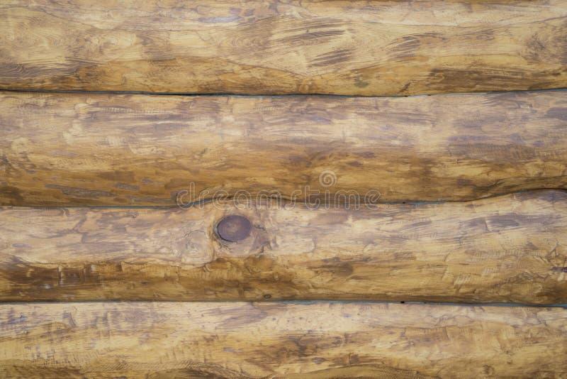 De textuur van de houten logboeken na verwerking stock afbeeldingen