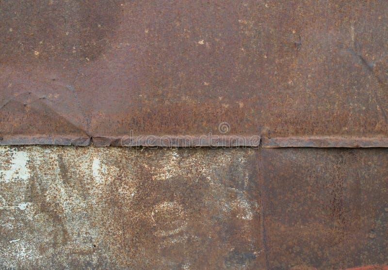 De textuur van de metaalmuur roest, rood, gebarsten ijzer royalty-vrije stock afbeelding