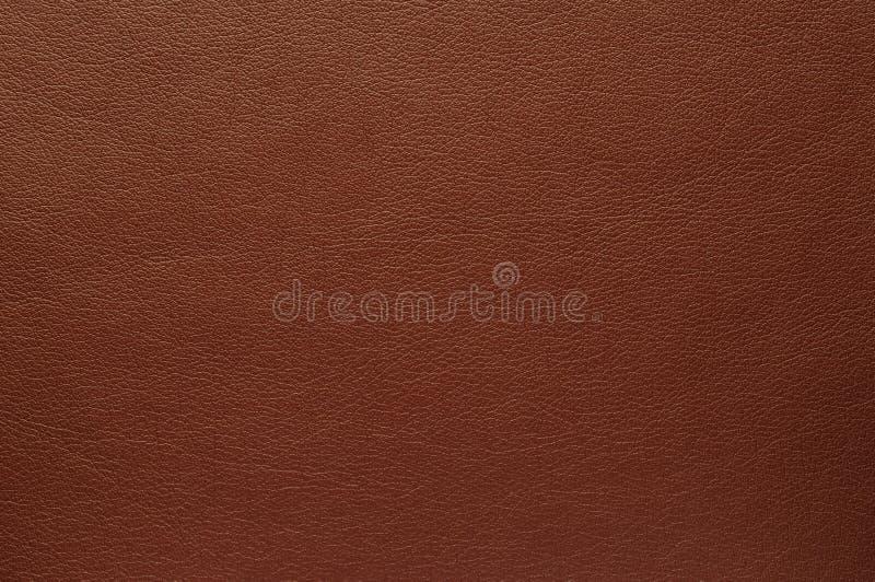 De textuur van de oppervlakte van kunstmatige Rijke bruine huid royalty-vrije stock foto