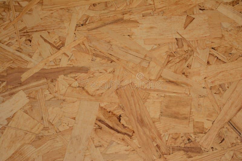 De textuur van de OSB-plaat wordt gemaakt van schaafsel en zaagsel, stukken van hout Eenvormige naadloze achtergrond royalty-vrije stock foto's