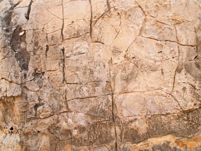 De textuur van steen voor achtergrondafbeeldingen, Oppervlakte wordt gebruikt van steen bruine kleur die stock foto