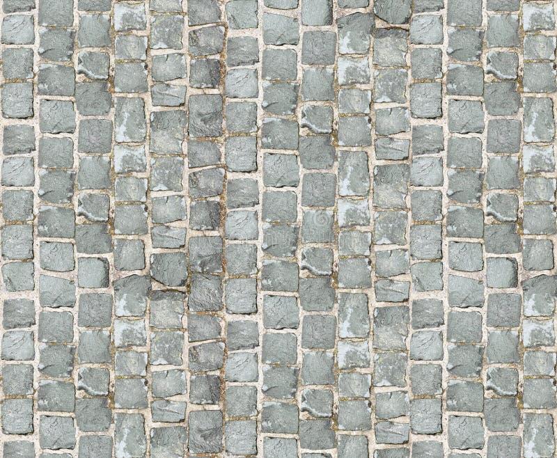 De textuur van de steenbestrating Het graniet cobblestoned bestratingsachtergrond Abstracte achtergrond van het oude close-up van royalty-vrije stock afbeeldingen