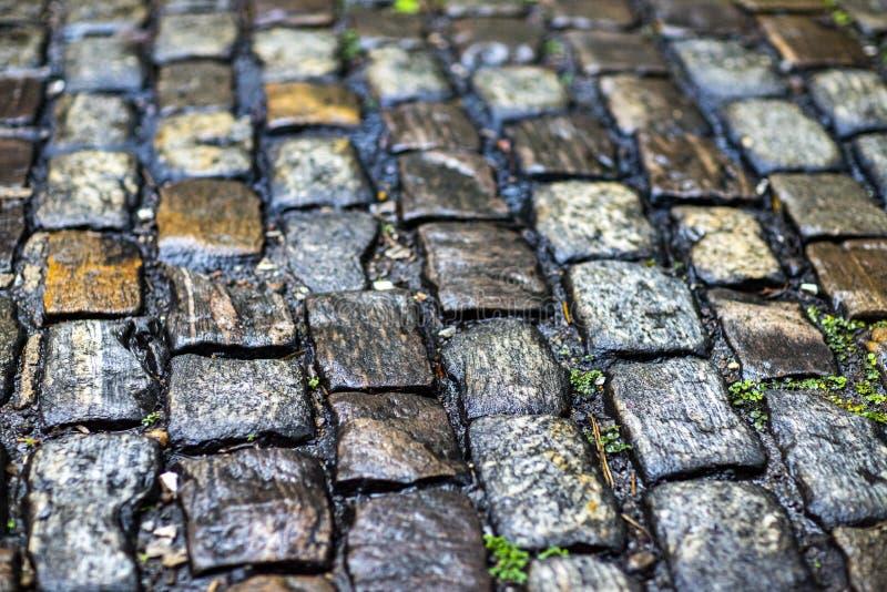 De textuur van de steenbestrating Het graniet cobblestoned bestratingsachtergrond royalty-vrije stock afbeelding
