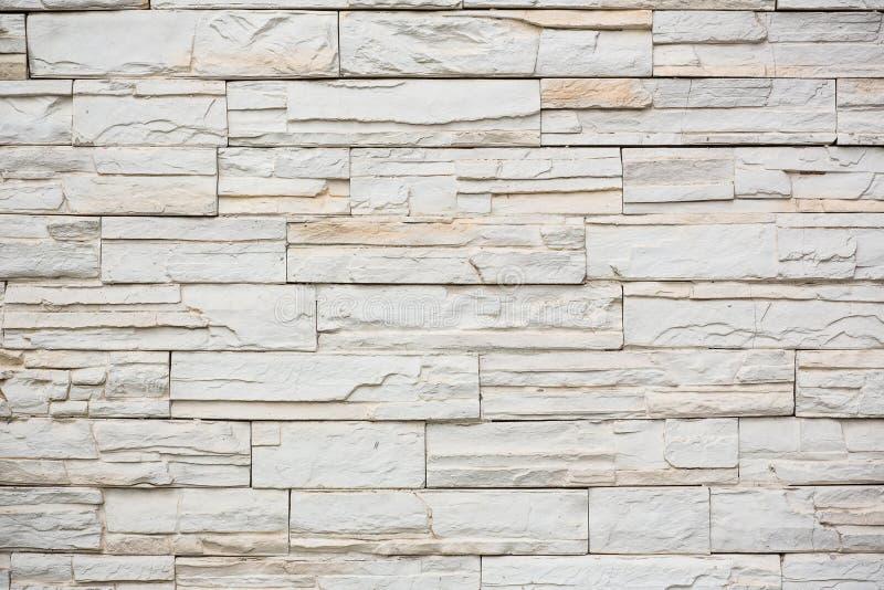 de de textuur van de steenmuur natuurlijke kleur als achtergrond Achtergrond van de textuurfoto van de steenmuur stock foto