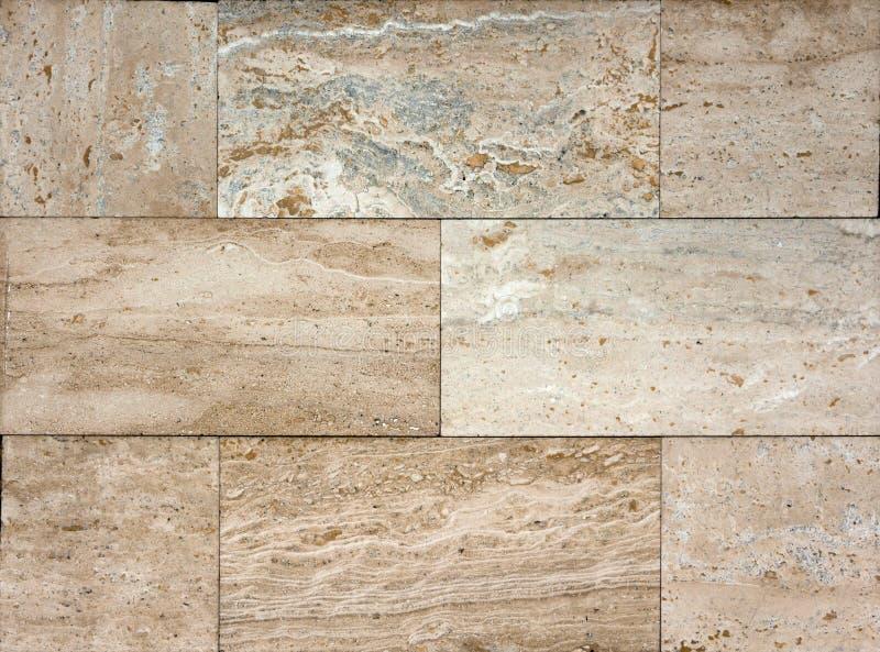 De textuur van de steenmuur, travertijntegels het onder ogen zien royalty-vrije stock afbeelding