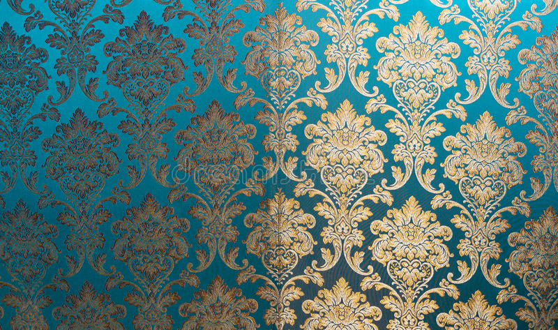 De textuur van zijde met een bloemenpatroon Chinees zijdebrokaat, mooie dure stoffenachtergrond Gouden ornamentturkoois em royalty-vrije stock foto