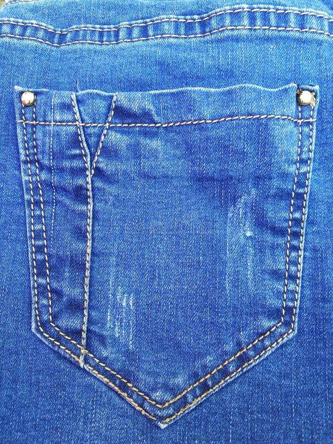 De textuurachtergrond van de jeans achterzak stock foto's