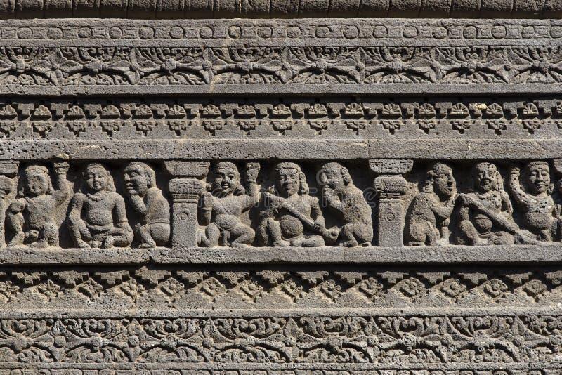 De textuurachtergrond van rotsgravures van Ellora Caves in Aurangabad, India Een Unesco-plaats van de werelderfenis in Maharashtr royalty-vrije stock foto