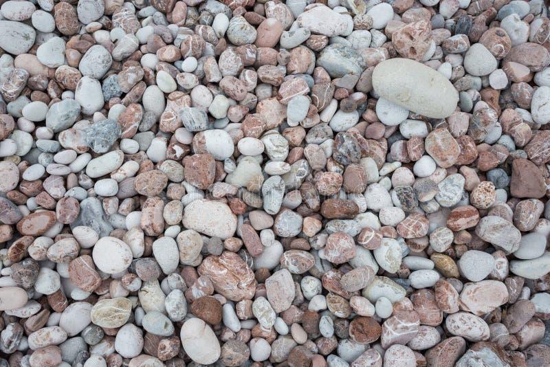 De textuurachtergrond van steenkiezelstenen voor binnenlandse buitendecoratie en industrieel bouwconcept stock afbeelding