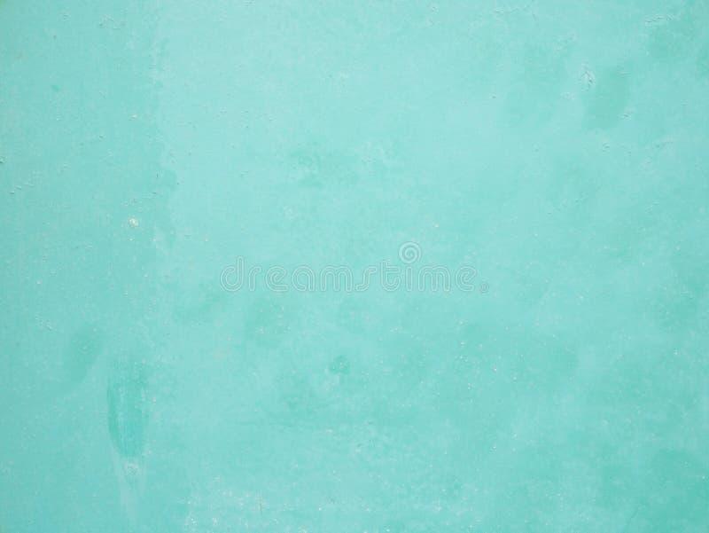 De textuurachtergrond van de wintertalings blauwgroene muur stock afbeelding