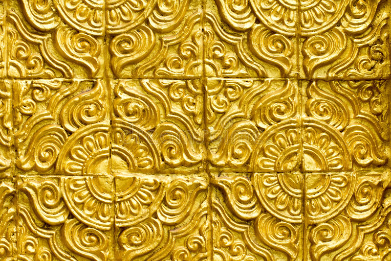 De Thaise gouden textuur van het muur mooie ontwerp stock foto