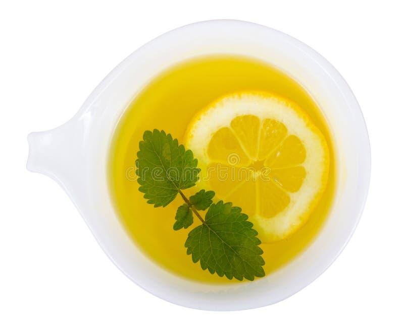 De thee van de citroenbalsem over witte achtergrond stock afbeelding