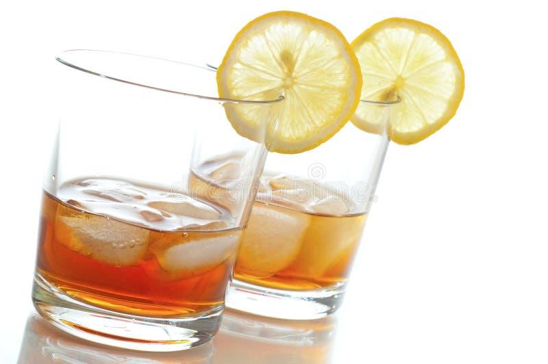 De thee van het ijs met citroen stock afbeeldingen