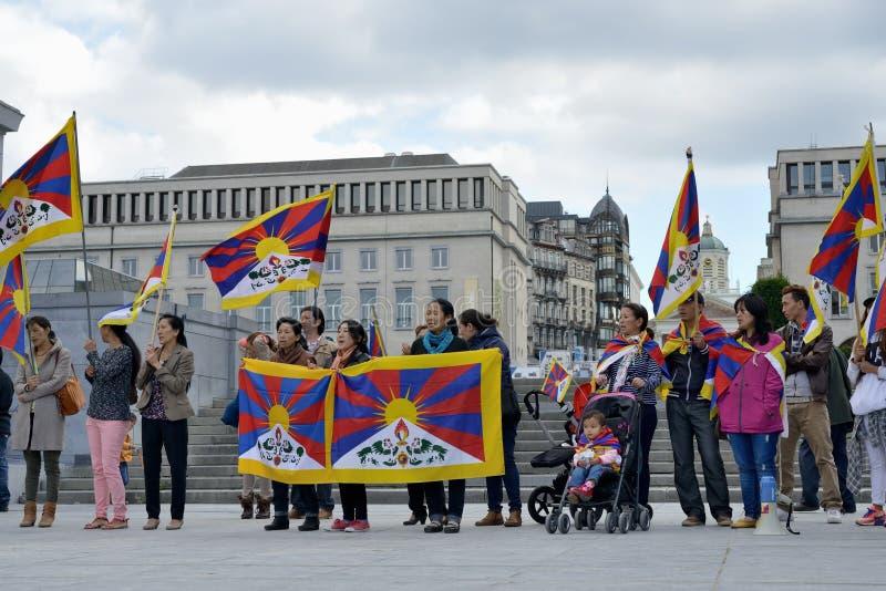 De Tibetaanse activisten tonen in Brussel aan stock fotografie