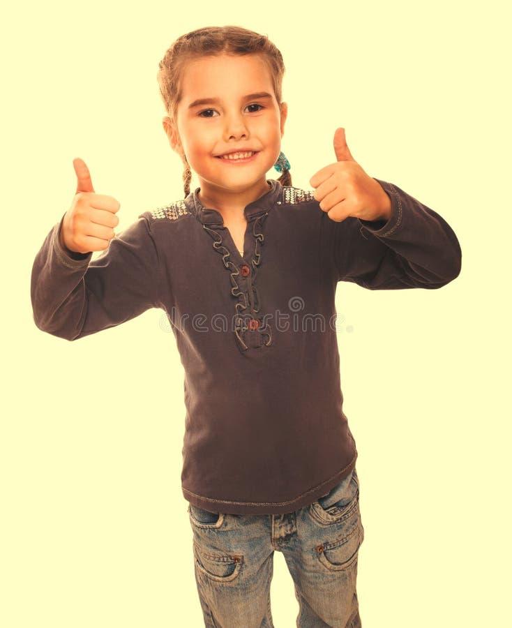 De tiener van het babymeisje hief haar duimen omhoog geïsoleerd het glimlachen symbool op stock fotografie