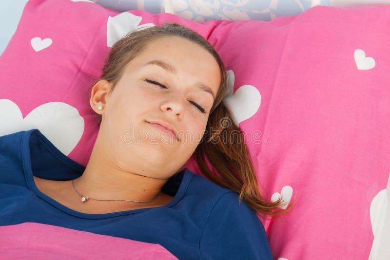 De tienermeisje van de slaap stock foto