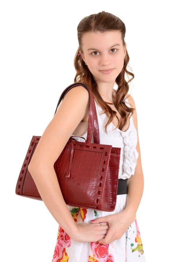 De tienermeisje van het portret met een beurs stock fotografie