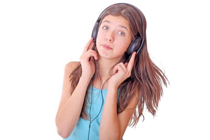 De tienermeisje van Nice met hoofdtelefoons royalty-vrije stock afbeeldingen
