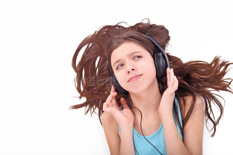 De tienermeisje van Nice met hoofdtelefoons royalty-vrije stock foto