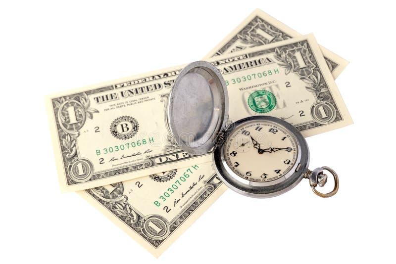 De tijd is geldconcept Twee rekeningen van één Amerikaanse dollar en een oud zakhorloge op een witte achtergrond Zaken en financi royalty-vrije stock fotografie