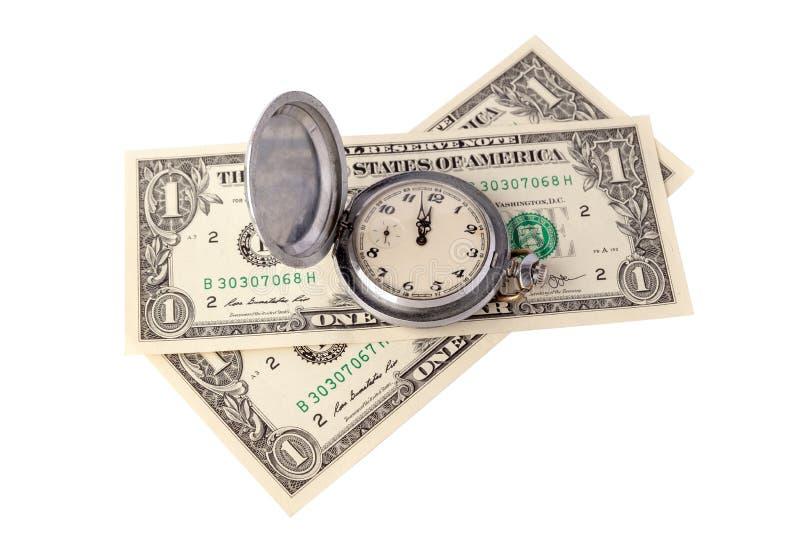De tijd van het concept is geld Twee dollars en een retro zakhorloge die twee minuten tonen aan middag of middernacht isoleer royalty-vrije stock foto's