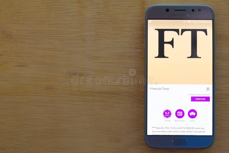 De toepassing van Financial Times dev op Smartphone-het scherm royalty-vrije stock afbeeldingen