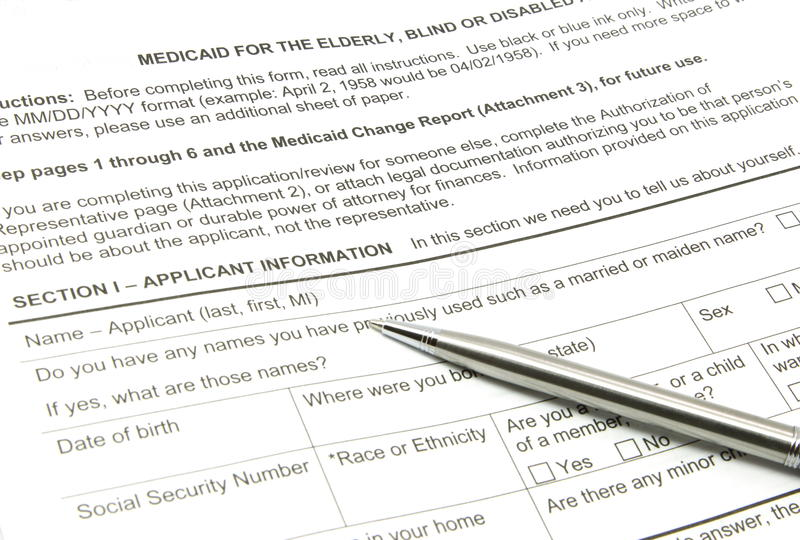 De Toepassing van Medicaid en Zilveren Pen royalty-vrije stock afbeeldingen