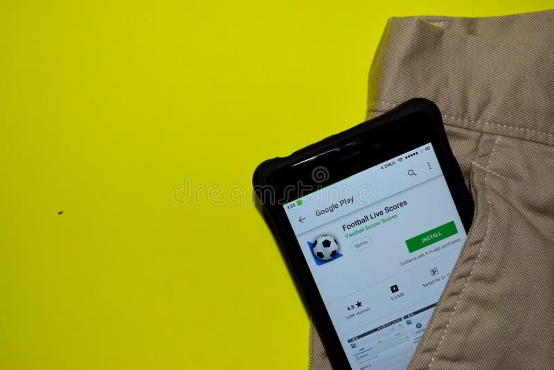De toepassing van voetballive scores dev op Smartphone-het scherm stock foto