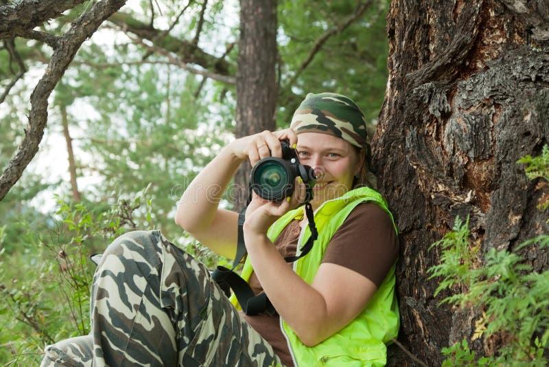 De toerist van de fotograaf neemt beelden stock afbeeldingen