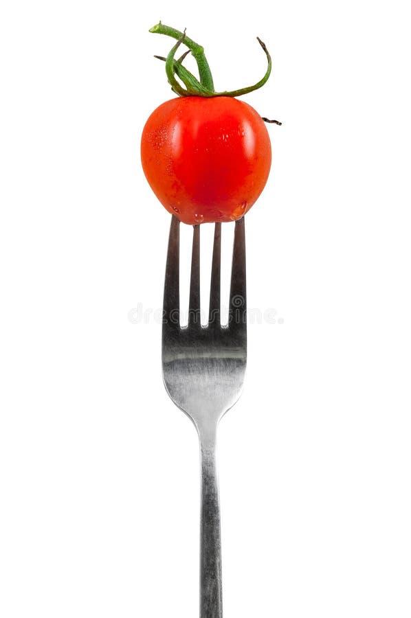 De tomaat van de kers op een vork royalty-vrije stock afbeeldingen