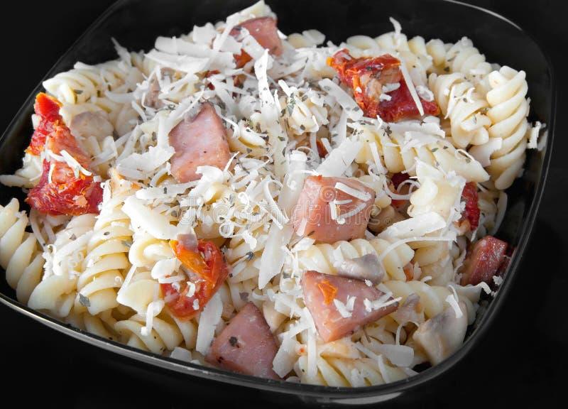 De tomatendeegwaren van het bacon stock afbeeldingen