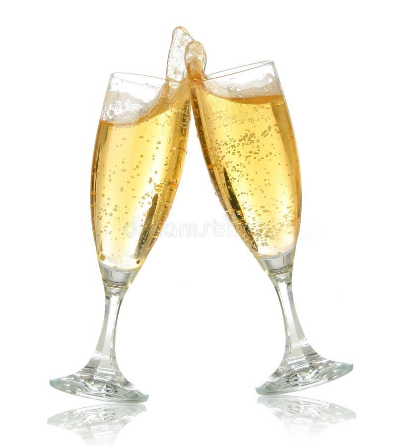 De toost van de viering met champag stock afbeeldingen