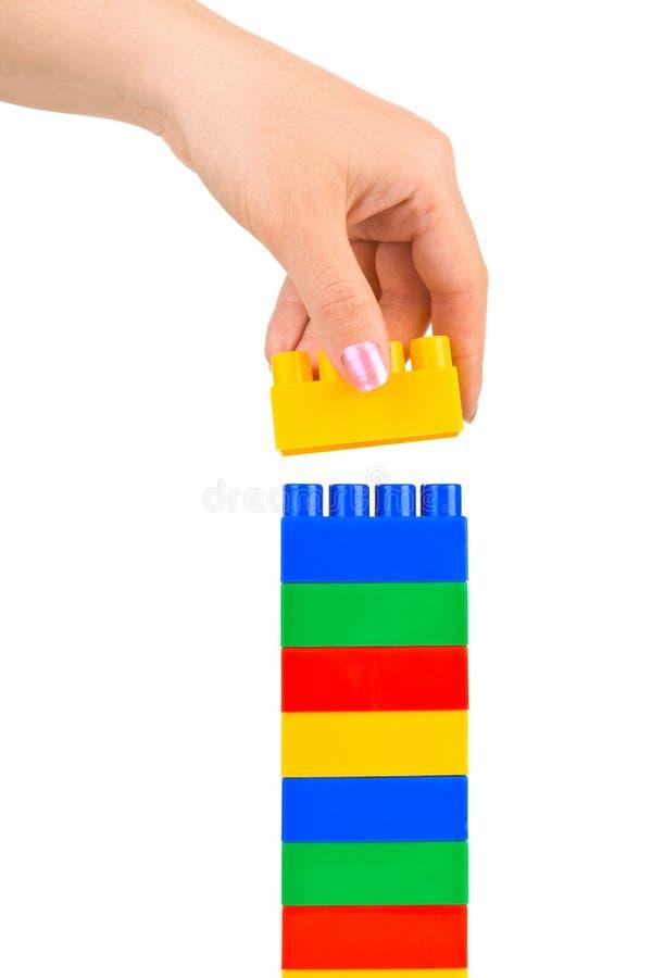 De toren van de hand en stuk speelgoed stock fotografie
