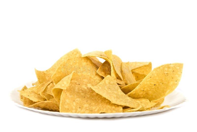 De tortillaspaanders van het graan (Mexicaanse spaanders) op document plaat royalty-vrije stock foto's