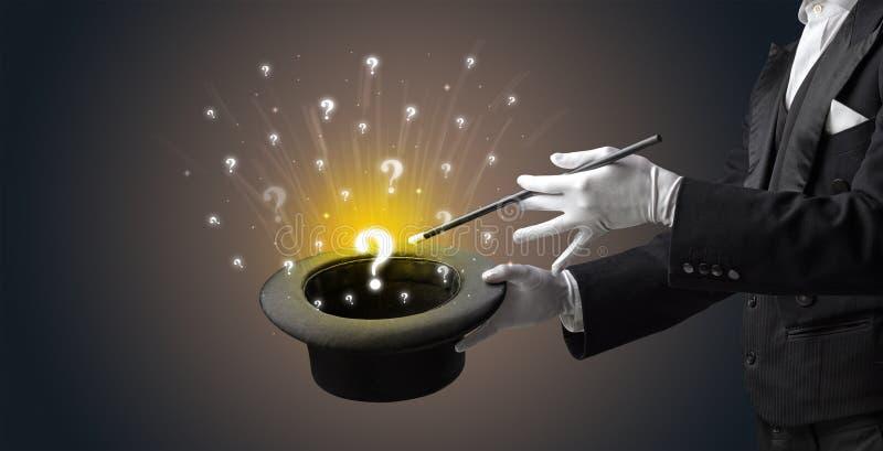 De tovenaar tovert vraagtekens van een cilinder royalty-vrije stock afbeelding