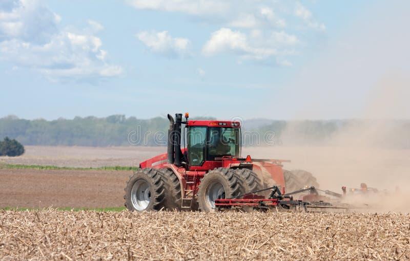 De Tractor van het landbouwbedrijf stock foto's