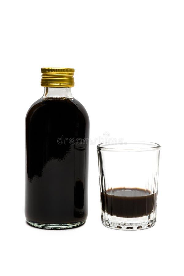 De traditionele Stroop van de Hoestdrug en een Glas die van Drug iSola meten royalty-vrije stock foto