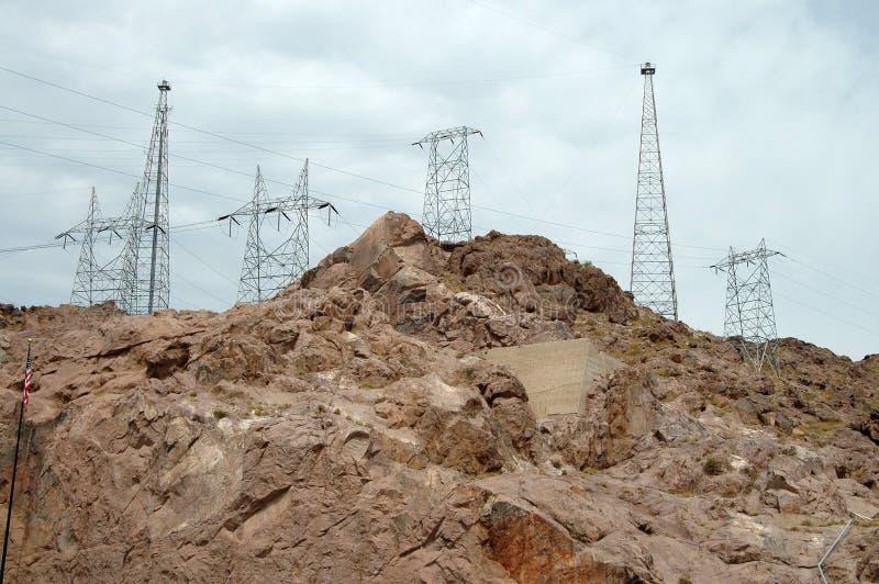 De transmissietorens van de macht stock afbeelding