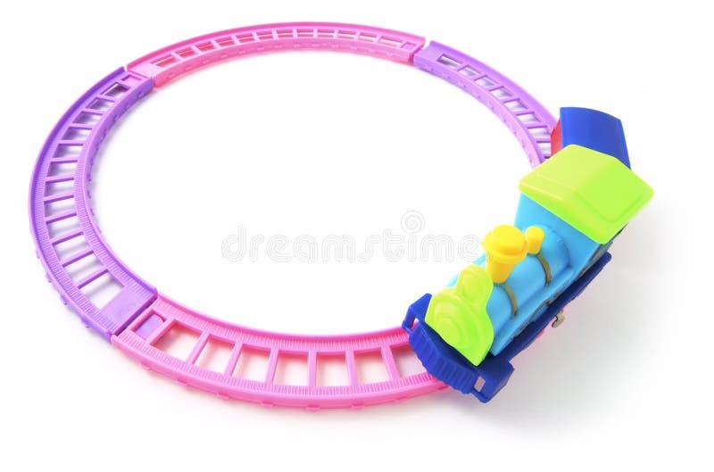 De Trein van het stuk speelgoed op RailwayTrack stock fotografie