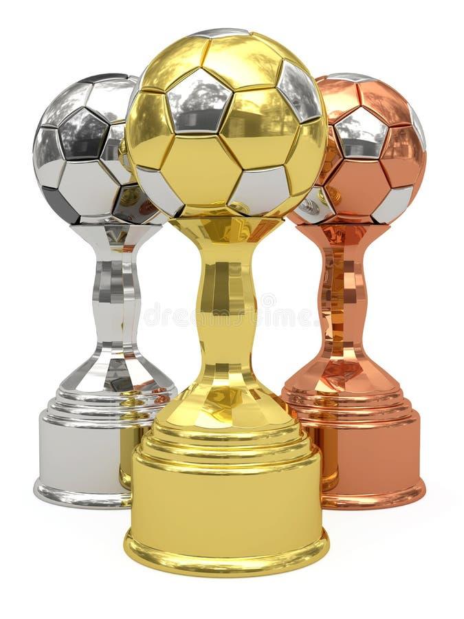 De trofeeën van het gouden, zilveren en bronsvoetbal stock afbeelding